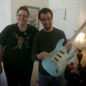 Tony R. Of Godsmack picking up his guitar.
